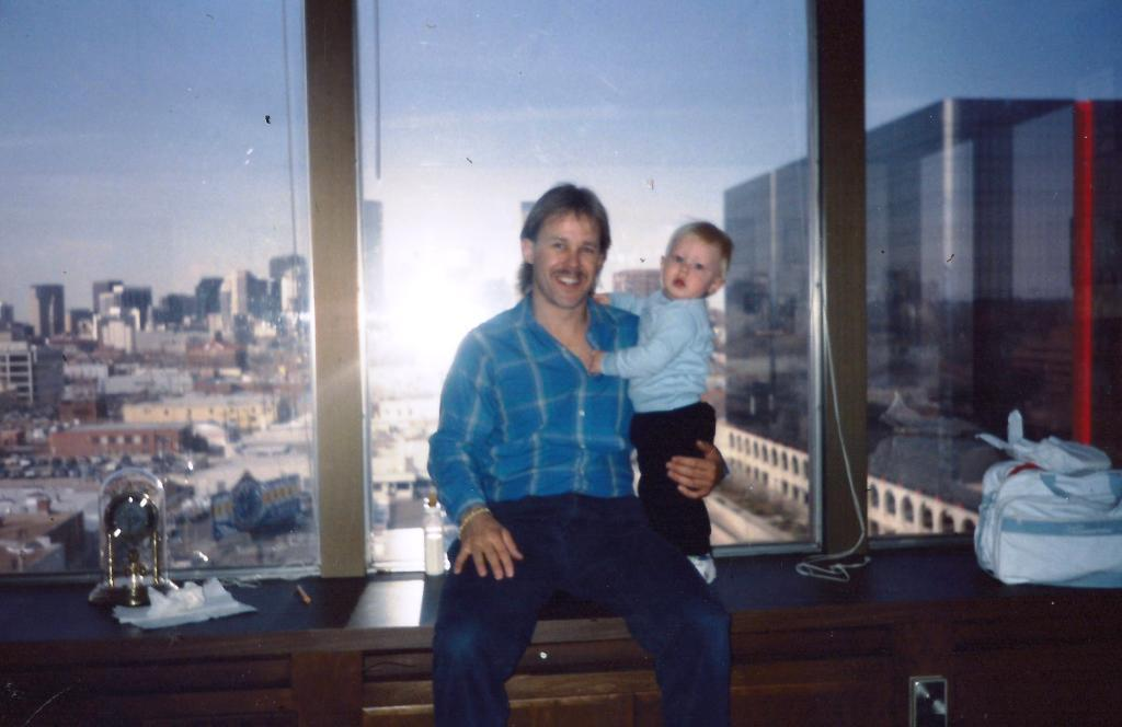 Nick with his son Nicholas at the A.S.P. office in Downtown Denver, Colorado